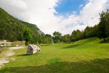 a beautiful park at the foot of a mountain in summer, with a natural lake  Stock Photo - 7856539