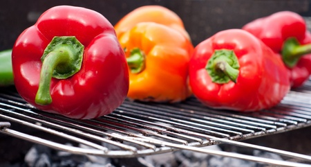 done with a barbecue grill and charcoal for the peppers and meat