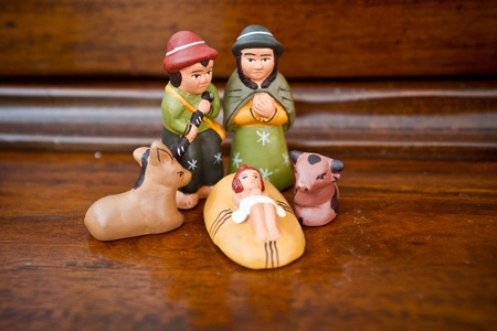 Christmas nativity scene with statues made ??and hand-colored photo