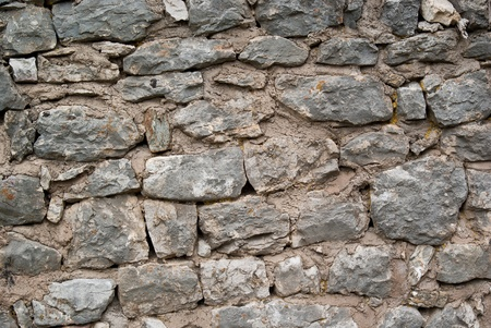 old stone wall at the foot of a medieval castle Stock Photo - 13101766
