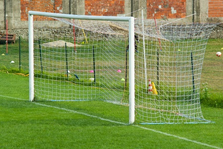 football goal in a field of well-kept province with short grass and very soft