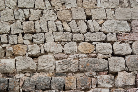 separators: old stone wall at the foot of a medieval castle