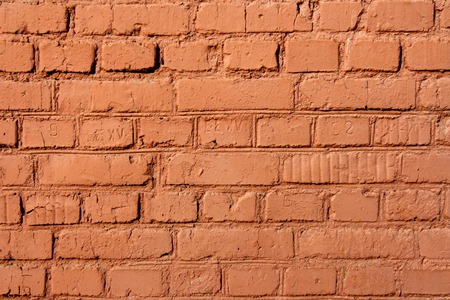 character traits: red brick wall on a sunny autumn day