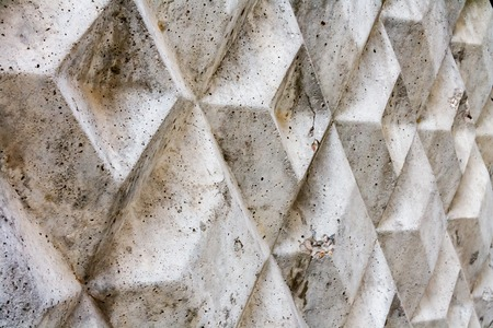 texture consisting of a portion of the gray concrete fence in autumn day photo