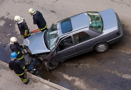 body work: Firemen at traffic accident site, checking car