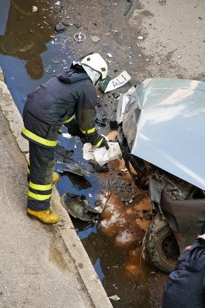 Fireman at traffic accident site Stock Photo - 7241529
