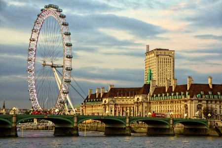 Westminster Bridge and the popular tourist attraction The Merlin Entertainments London Eye in London, United Kingdom