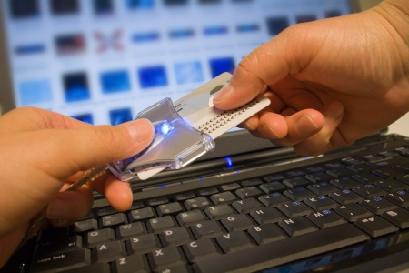 Putting ID-card into card reader; electronic identity, security, banking, e-commerce, online shopping concept photo