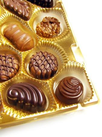 Open box of assorted chocolates photo