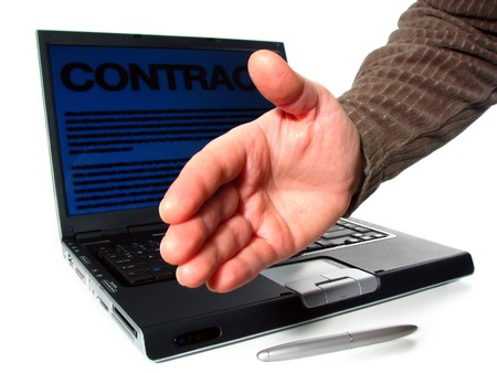 It's a deal: laptop, digital pen and reached out  hand; word contract on computer screen Stock Photo - 7399127