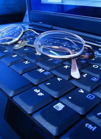 Glasses on the laptop keyboard Stock Photo - 7399033