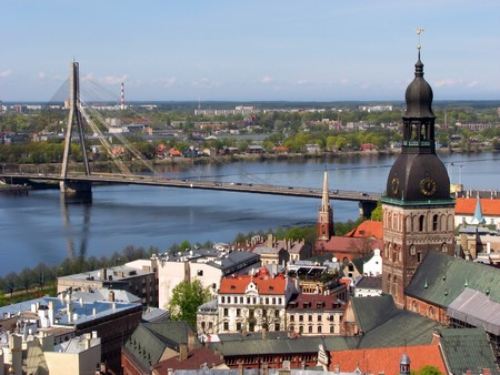 Vansu bridge over Daugava river in Riga, Latvia; Old Town of Riga with Lutheran Dome Cathedral in front photo