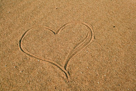 Heart sign drawn on the sandbeach Stock Photo - 7404105