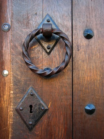 Ancient wooden door with metal knobs and keyhole Stock Photo - 7398502