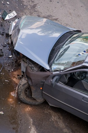 Damaged car after traffic accident, front demolished photo