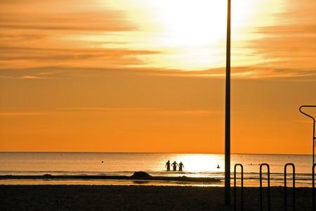Going to swim on sunset beach Stock Photo - 7435883