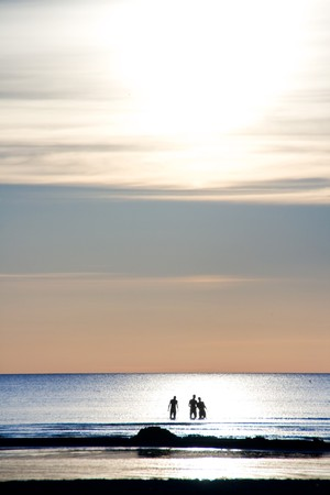 Three silhouettes in the blue ocean Stock Photo - 7435824