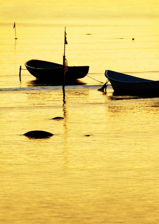 Anchored fishing boats in sunset light photo