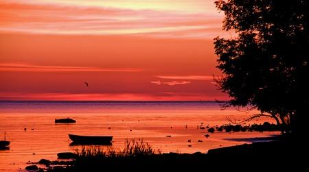Sunset landscape with seashore and fishing fishing boat Stock Photo - 7435840