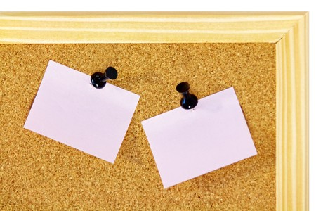 Pink pinned notes on brown corkboard with wooden frame photo