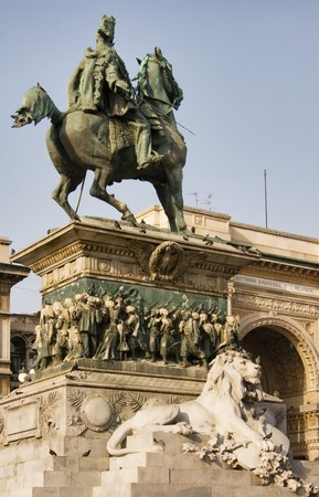 Picture of Vittorio Emanuele II Statue (Ercole Rosa, 1896) in Piazza del Duomo, Milan, Italy; shopping center Galleria Vittorio Emanuele II on the background photo