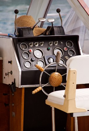 Motor boat interior with seat, wheel and control panel photo