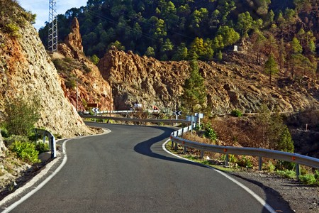 A smooth paved road winding through mountains photo