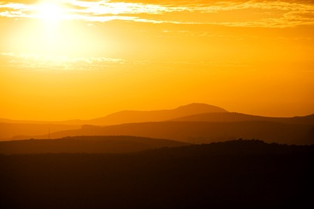 Golden sunset over Gran Canarian mountain silhouettes Stock Photo - 7435801