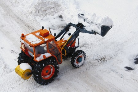 Snowplow clearing snow from street Stock Photo - 7436027