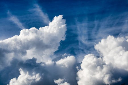 Blue sky background with bright white storm clouds Stock Photo - 8130428