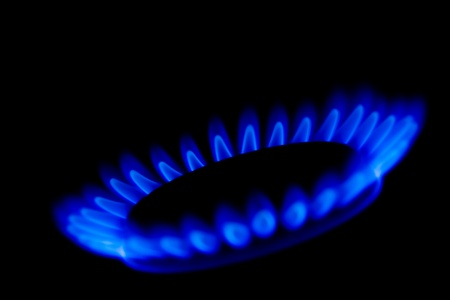 A ring of blue gas flames in the dark photo
