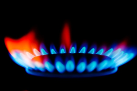 gas stove: Blue and red flames of a gas stove in the dark