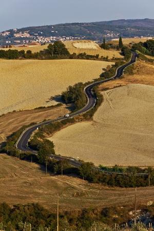 Winding roads on the clay hills of Crete Senesi in Tuscany, Italy photo