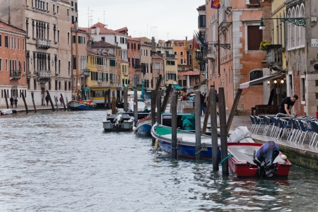 VENICE, ITALY - APRIL 19: Common view of Grand Canal on April 19, 2012 in Venice, Italy. The city of Venice is listed as World Heritage Site, along with its lagoon since 1987.
