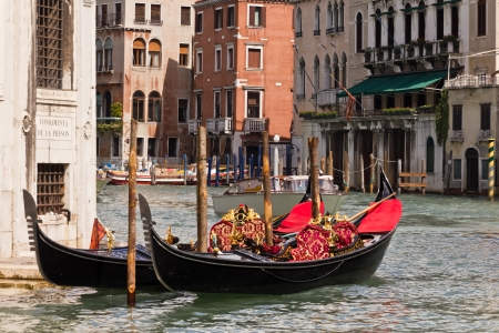 Two luxurious gondolas on Venetian Grand Canal, Venice, Italy photo