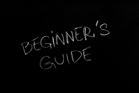 Handwritten chalk text Beginner's Guide on the blackboard photo