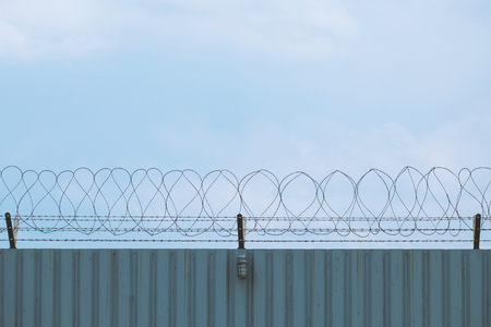 steel wave plate  wall with barbed-wire , imprison area