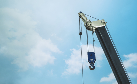 residential construction: A large crane is working on blue sky background
