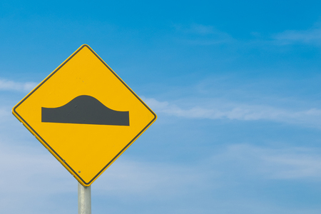 Speed bump traffic sign on blue sky background with clipping path included Stock Photo