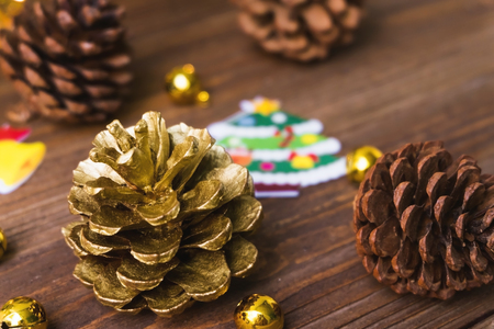 christmas grounds: Golden pine cone , brown pine cone , gift,snow man and gold bell prepare for Christmas party. Stock Photo