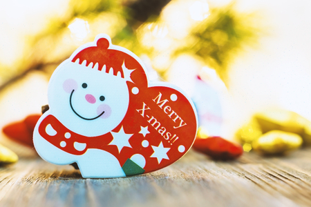 Snow man and golden Christmas star place on wooden table,Decoration for Christmas season coming. Stock Photo