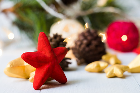 Red Christmas star  placed on wooden floor ,prepare for Christmas party