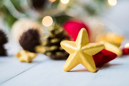 Gold Christmas star  placed on wooden floor ,prepare for Christmas party