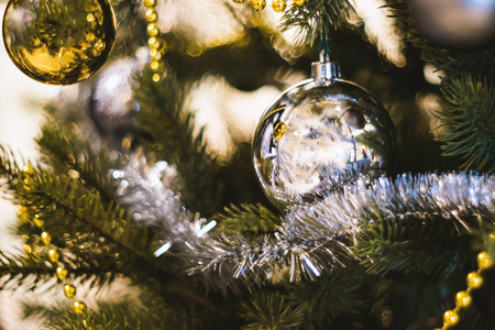 Soft focused on Silver ball Christmas celebration accessories on Christmas tree prepare for the Christmas and happy New Year festival