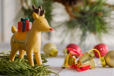 Christmas reindeer bring the gift box to people in Christmas night.