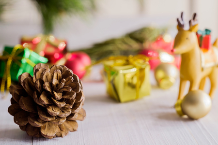 christmas grounds: Pine cones and Christmas party accessories on wooden table