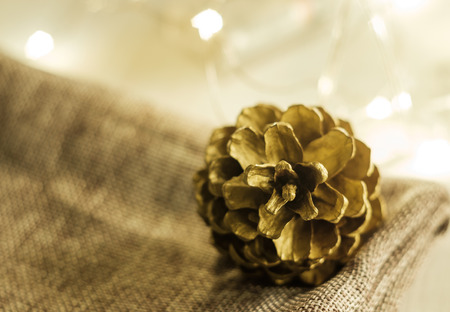 Soft focused on Pine cones put on grey cloth and Christmas party accessories on wooden table Stock Photo