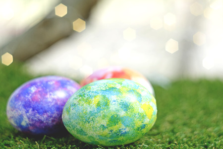 Easter egg laying in the grass bright green.Meaning  celebrate Easter seasonal. Festival of the beginning And rebirth Stock Photo