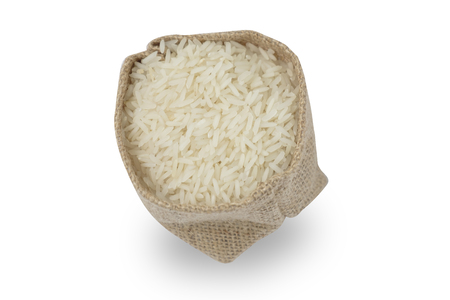 Rice in sack isolated on white background with clipping path included.