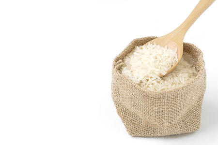 Rice in sack on white background Stockfoto